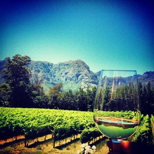 Travel Blogger Katy Johnson sips wine in Tuscany.