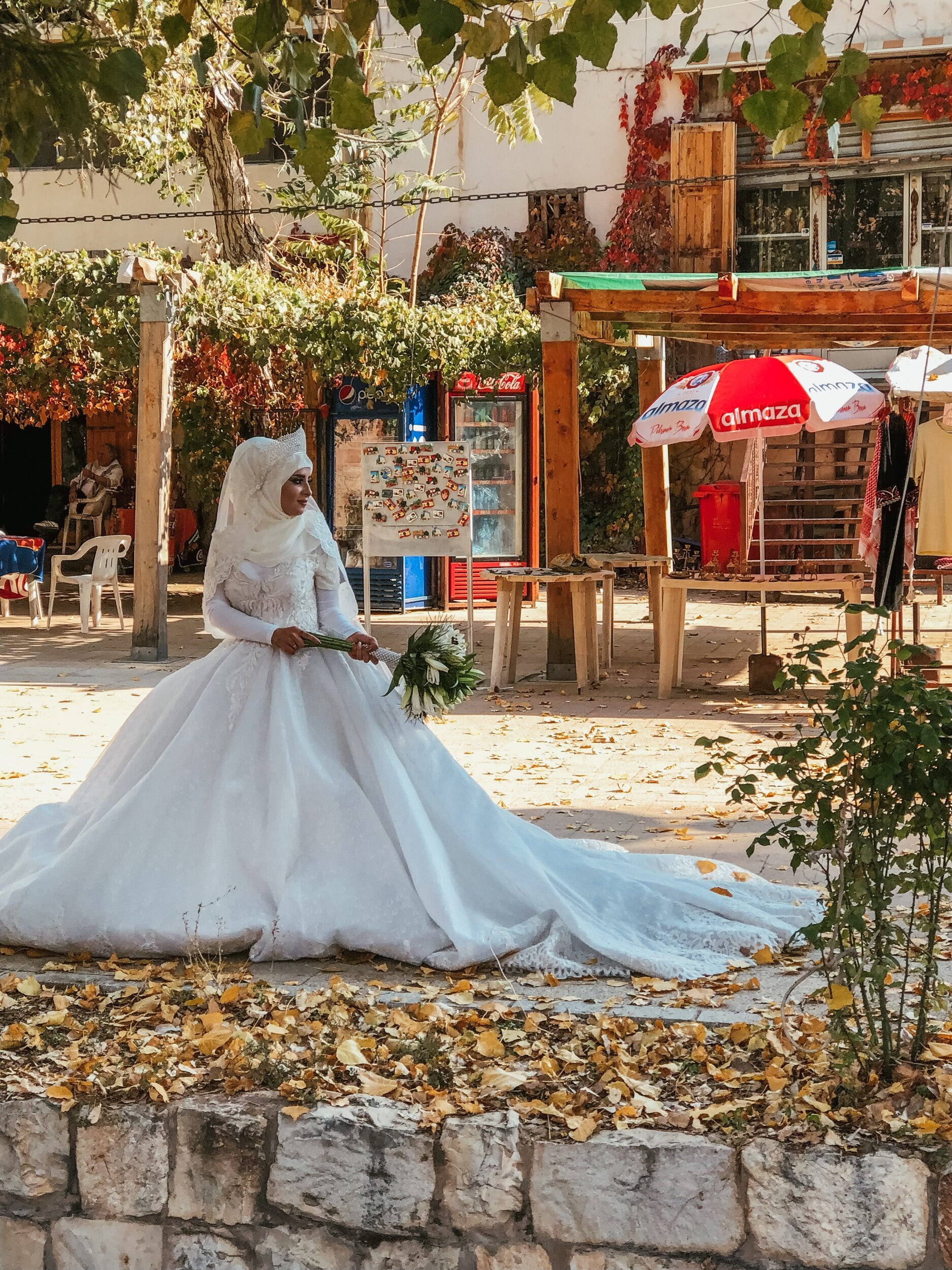 I snuck up on a wedding photoshoot in a more rural part of Lebanon, where woman tend to cover more. They're also a bit more traditional and conservative outside of Beirut.