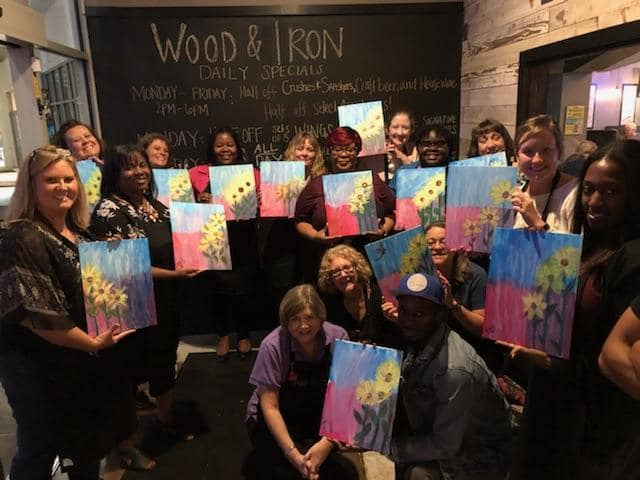 Paint Night for Alzheimer's research with Encompass Home Health & Hospice at Wood & Iron Game Day restaurant.  Painting:  Yellow Flower