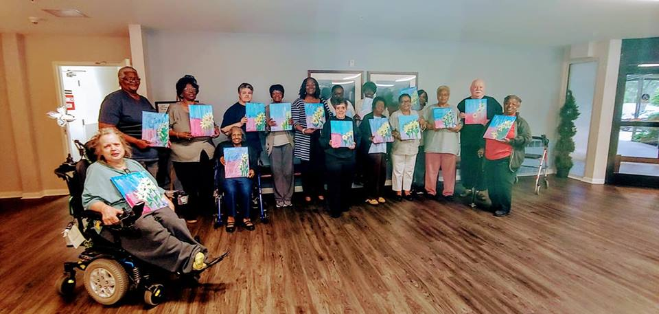 Resident Paint Night at Chesterfield Square Senior Apartments   Painting: Yellow Flower