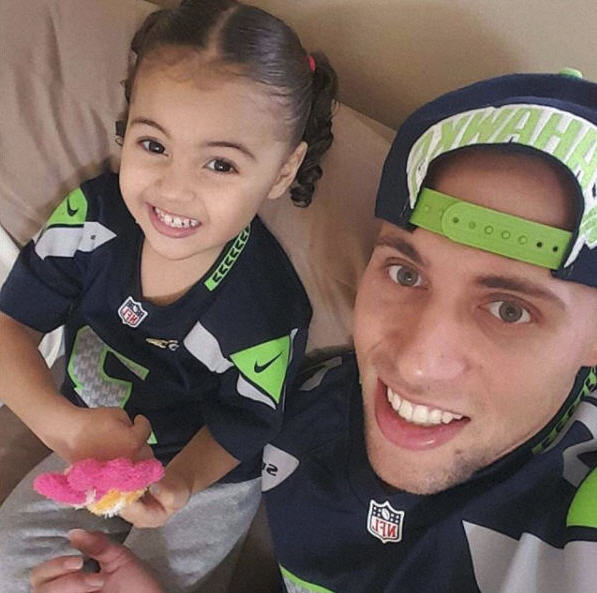 TJ Tyler with daughter Maya.jpg