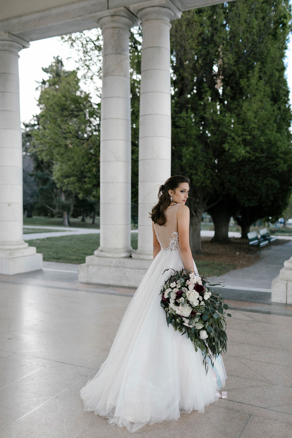Bride with large over-sized cascade bouquet - fresh flowers