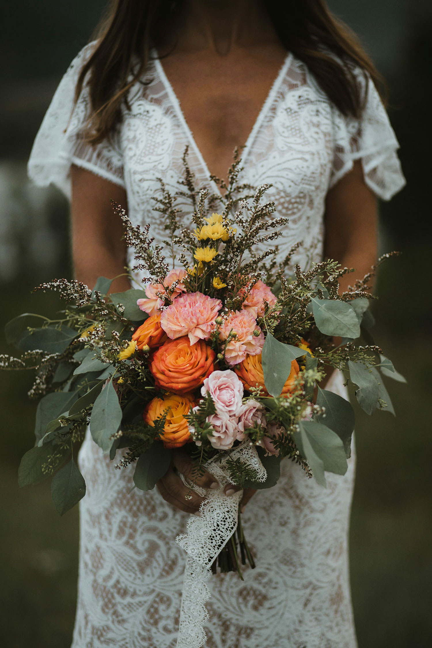 Boho Bride with hand-tied bouquet - fresh flowers