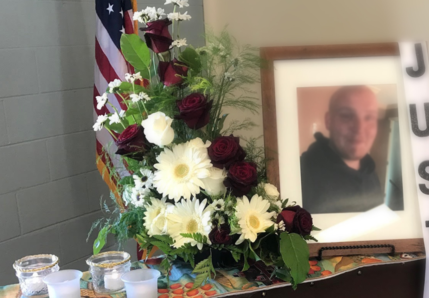 photo memorial arrangement from family with ribbon - fresh flowers