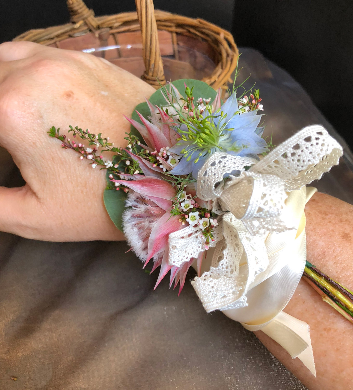boho ribbon wrist corsage - fresh flowers with cotton ribbon bow and satin ribbon wrap