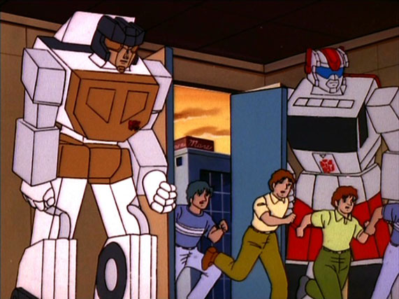 Streetwise and Groove helping a group of humans,  The Transformers  (G1)