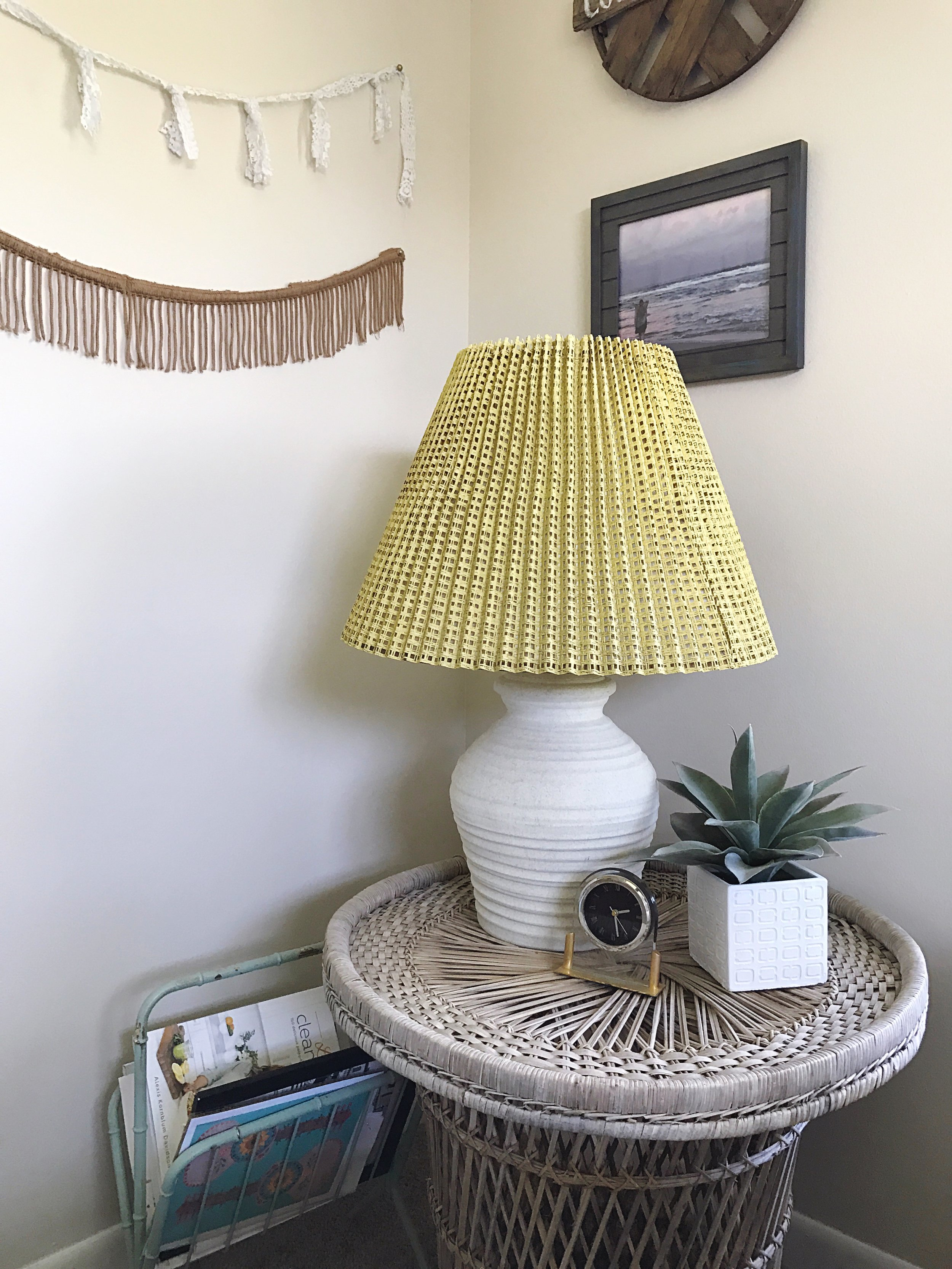 Most of the things in this picture were found at thrift stores. The only ones that weren't are the faux plant from Home Goods and the wall art. That lamp was a neat random find from a store that was having a 40% off lighting sale. I got him for $7. The side table was only $10.