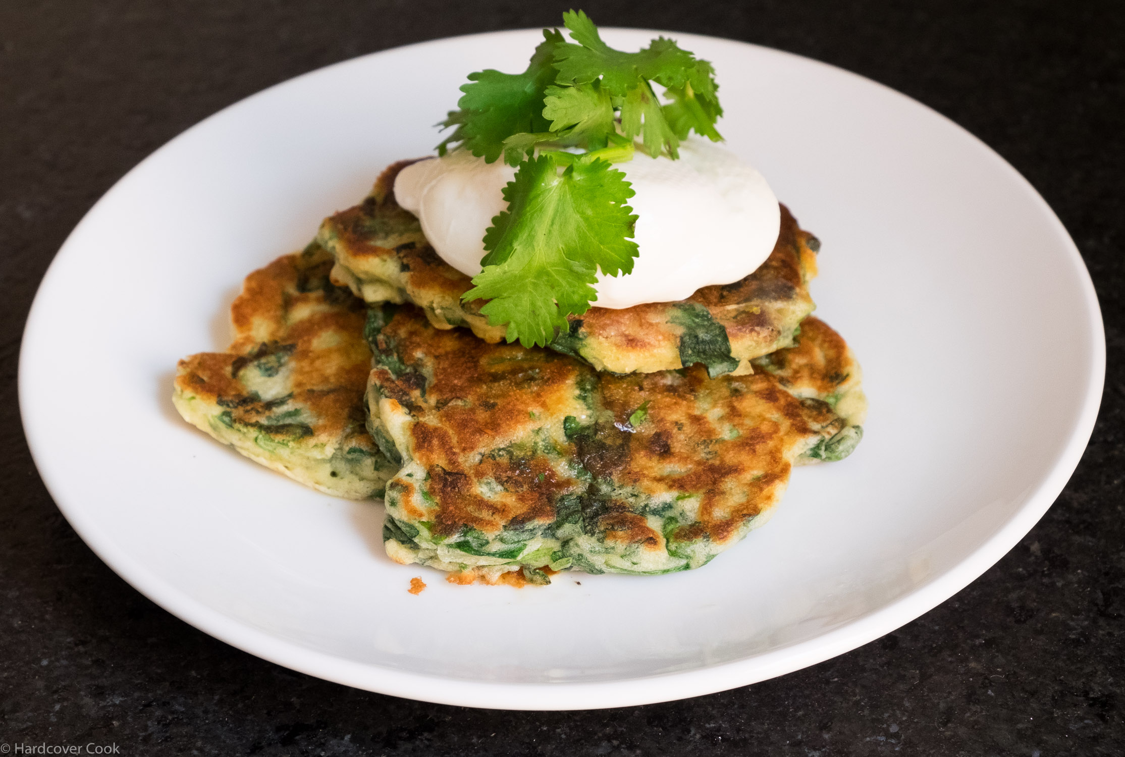 Savory pancakes served for brunch with a poached egg