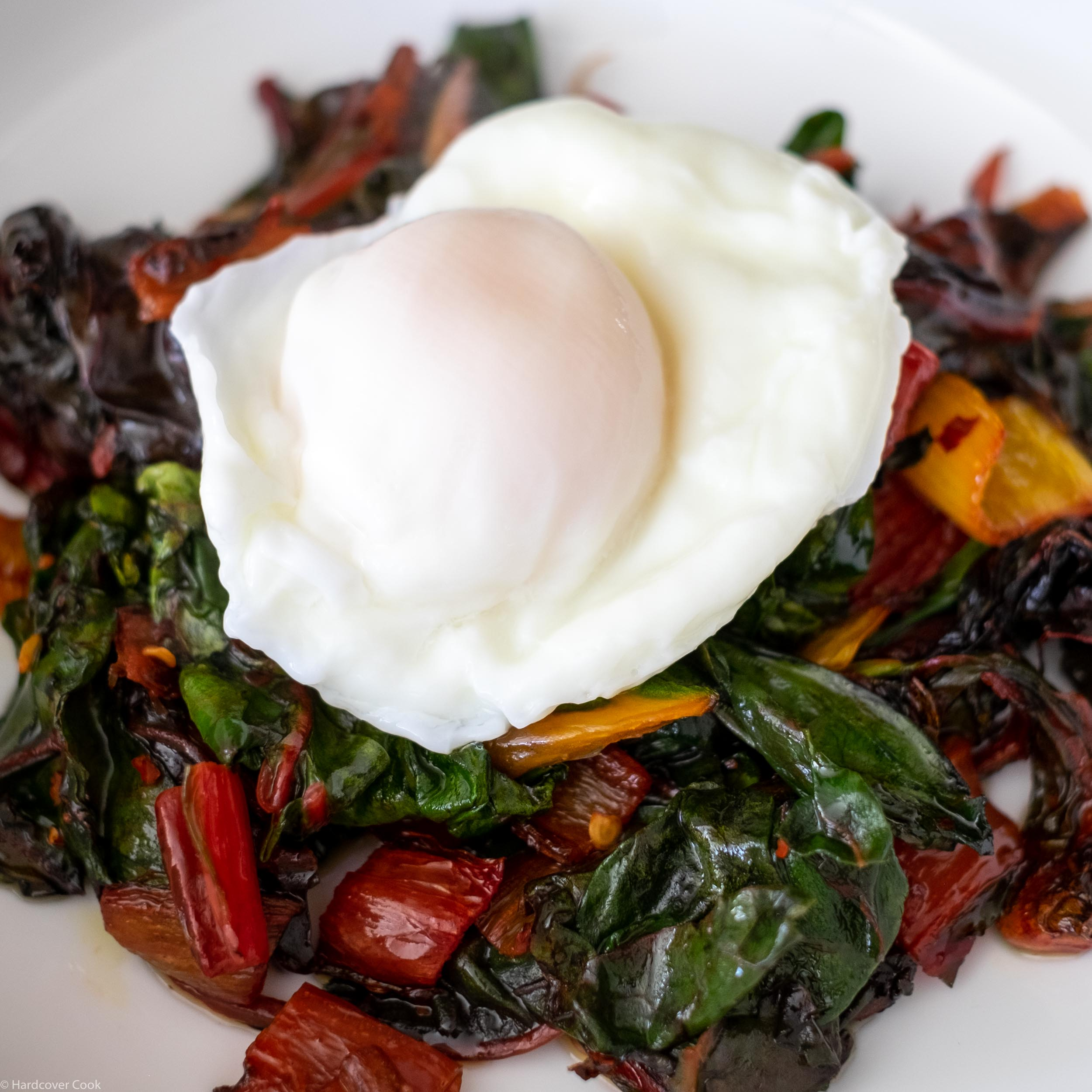 poached-egg-and-silky-braised-greens-from-where-cooking-begins-sq.jpg
