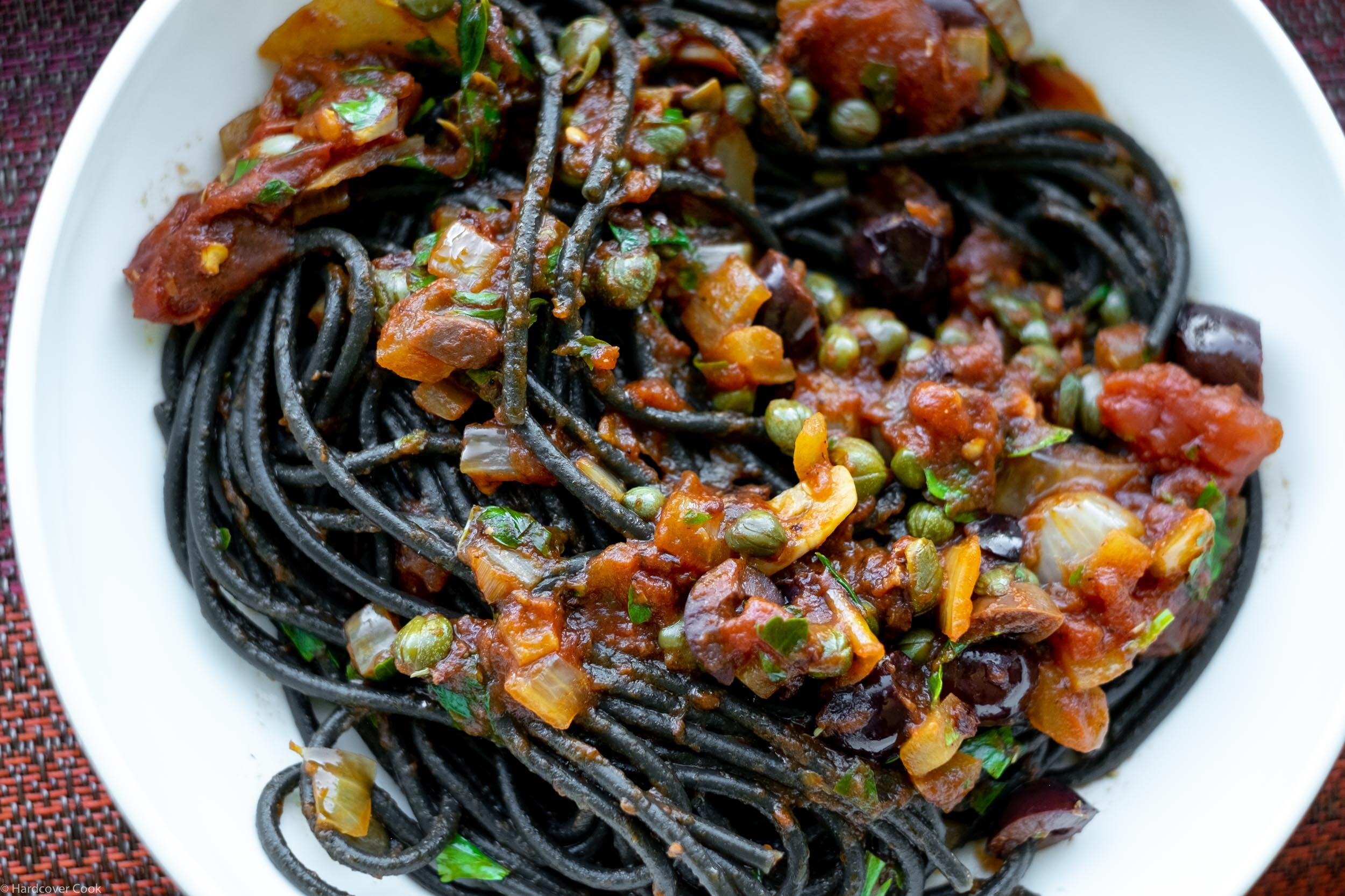 Squid Ink Tonnarelli Puttanesca from The Pasta Friday Cookbook