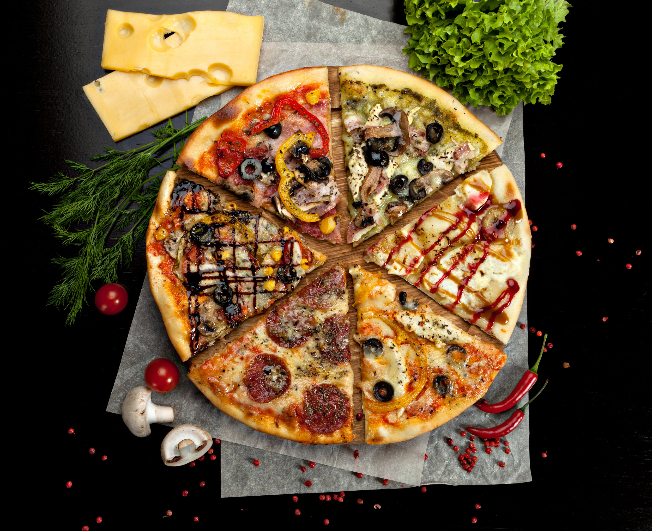 World Inspired - Our pizzas are inspired by cuisines from all over the globe - America, India, China, Ethiopia, Portugal, Hawaii, Greece and many more. They are plenty of home-style Italian pizzas too. It's not just something you eat, it's an experience of the whole world on a plate, and the best part... you don't need a ticket to travel.