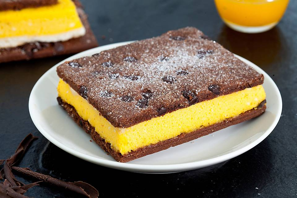 Mango Bourbon - Bring those dessert spoons out and get ready to taste a dessert that is quite simply put – supercalifragilisticexpialidocious!Two slabs of chocolate-chips riddled chocolate biscuits fortify a delicious spongy, cakey mixture of white chocolate, cream, condensed milk, eggs and the hero of the season – mango. What are you waiting for?! Try, now!