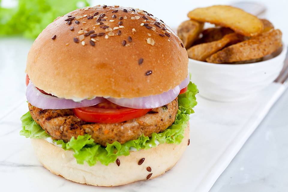 If there's one thing, the Americans love more than a good rodeo, it's a good meaty burger. This meaty burger is good enough to tickle your taste buds and capture your heart. A hearty, cheesy, flavoursome patty is placed between soft, buttered burger buns, sliced veggies and slathered with ranch dressing. Burgers can't get better than this. The American dream begins with burgers like these!