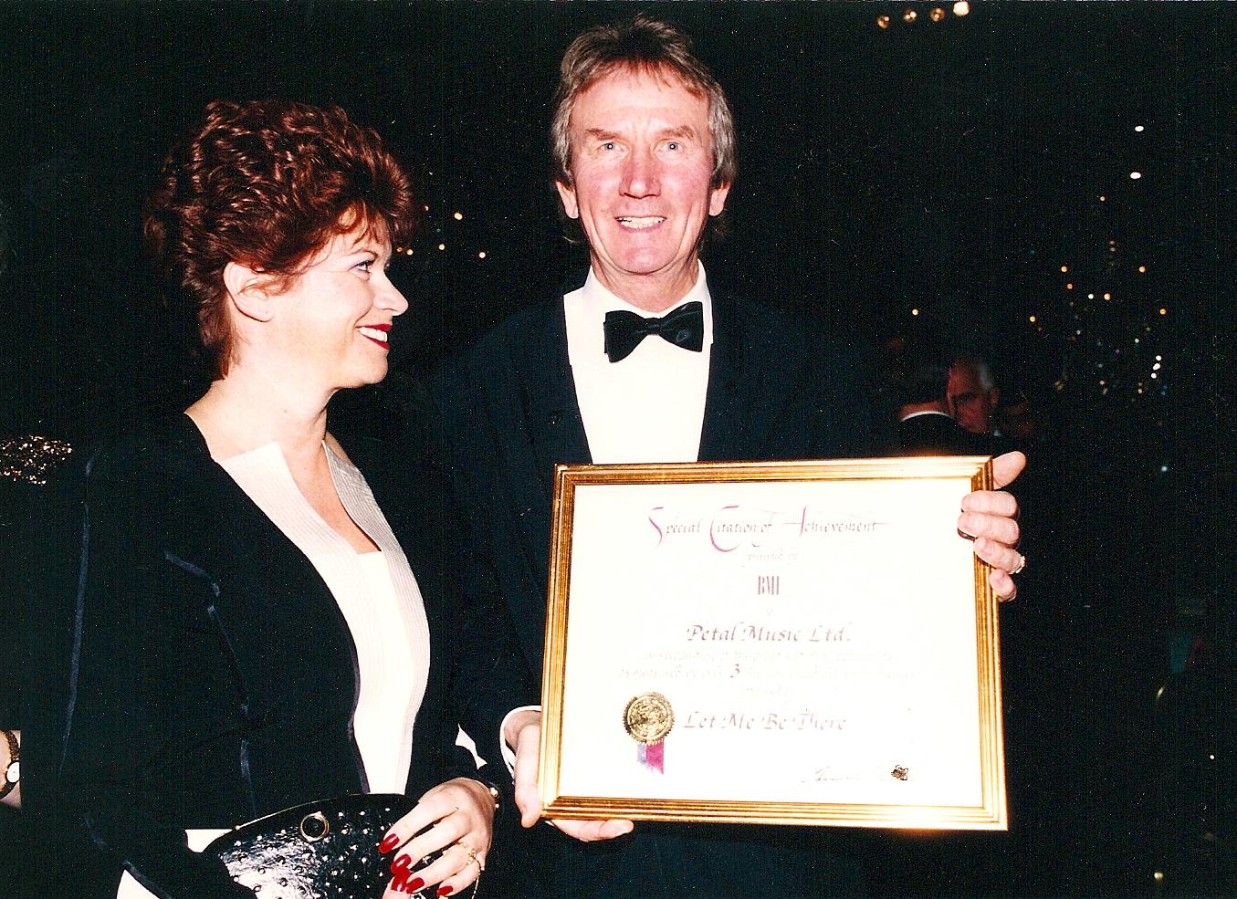 AWARDS - Chris smiles at this award copy.jpg