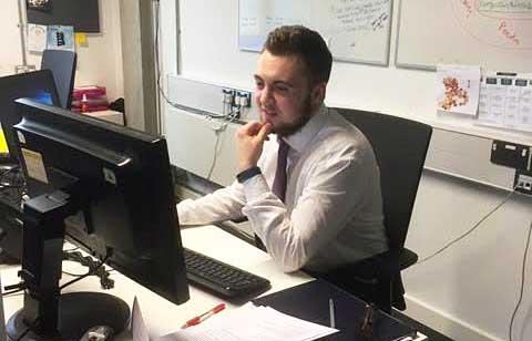 Dan Coleman at his desk