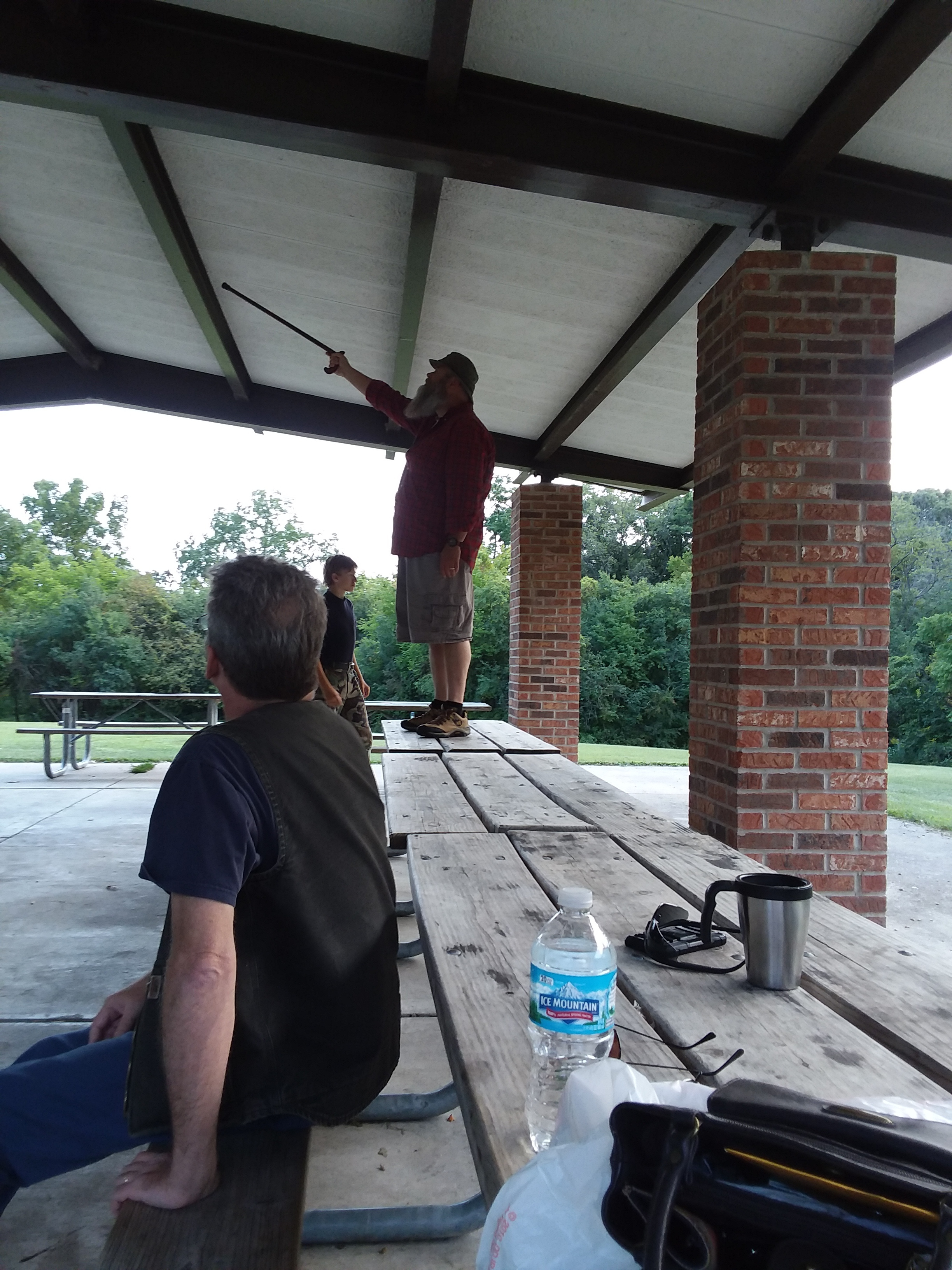 Mike (N9PLG), Kyle (Strango), and John (KD9BYW). BYW pointing out nature in the upper foundation of the outdoor structure.