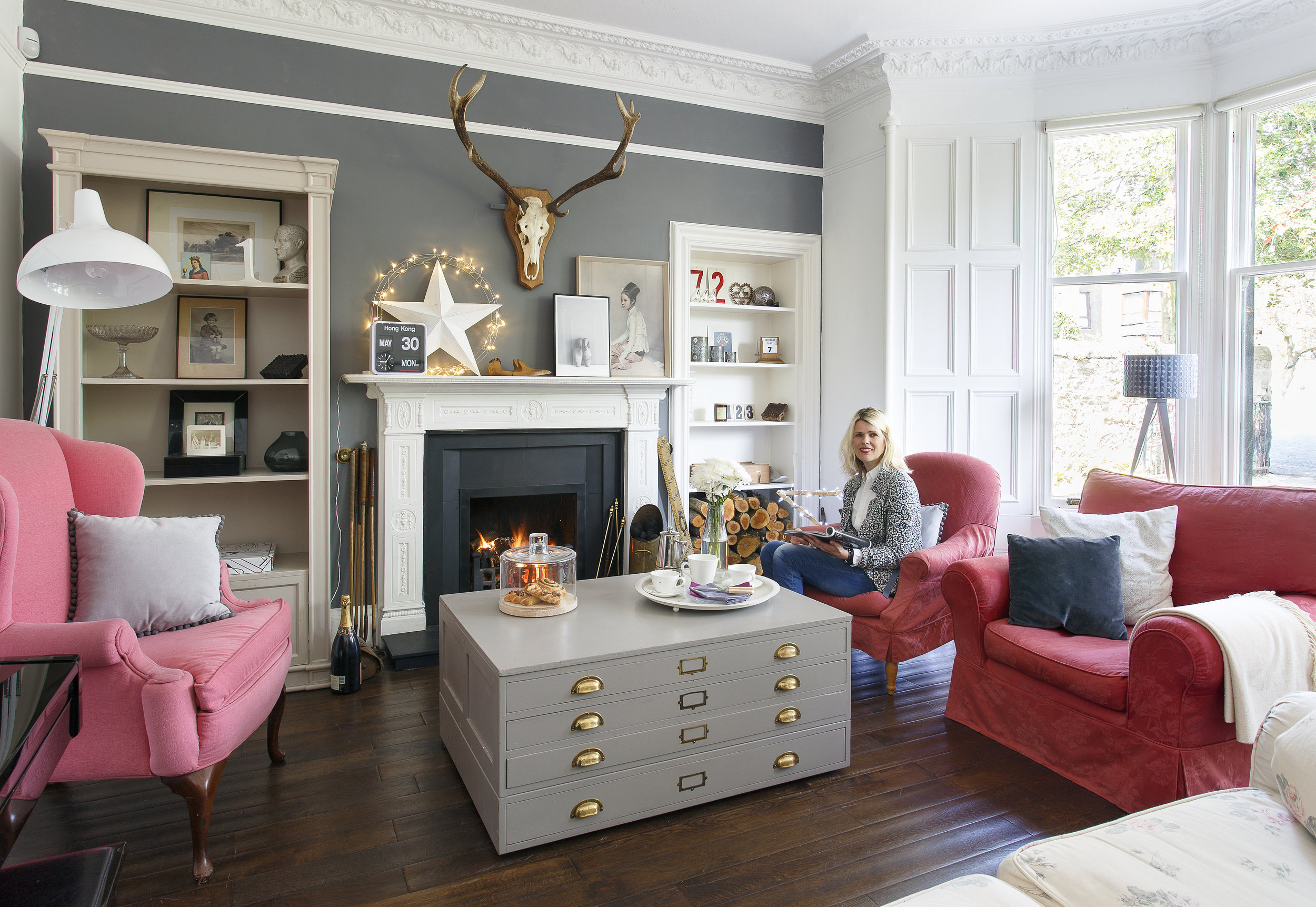 The chimney wall is painted in 'Downpipe' by Farrow & Ball