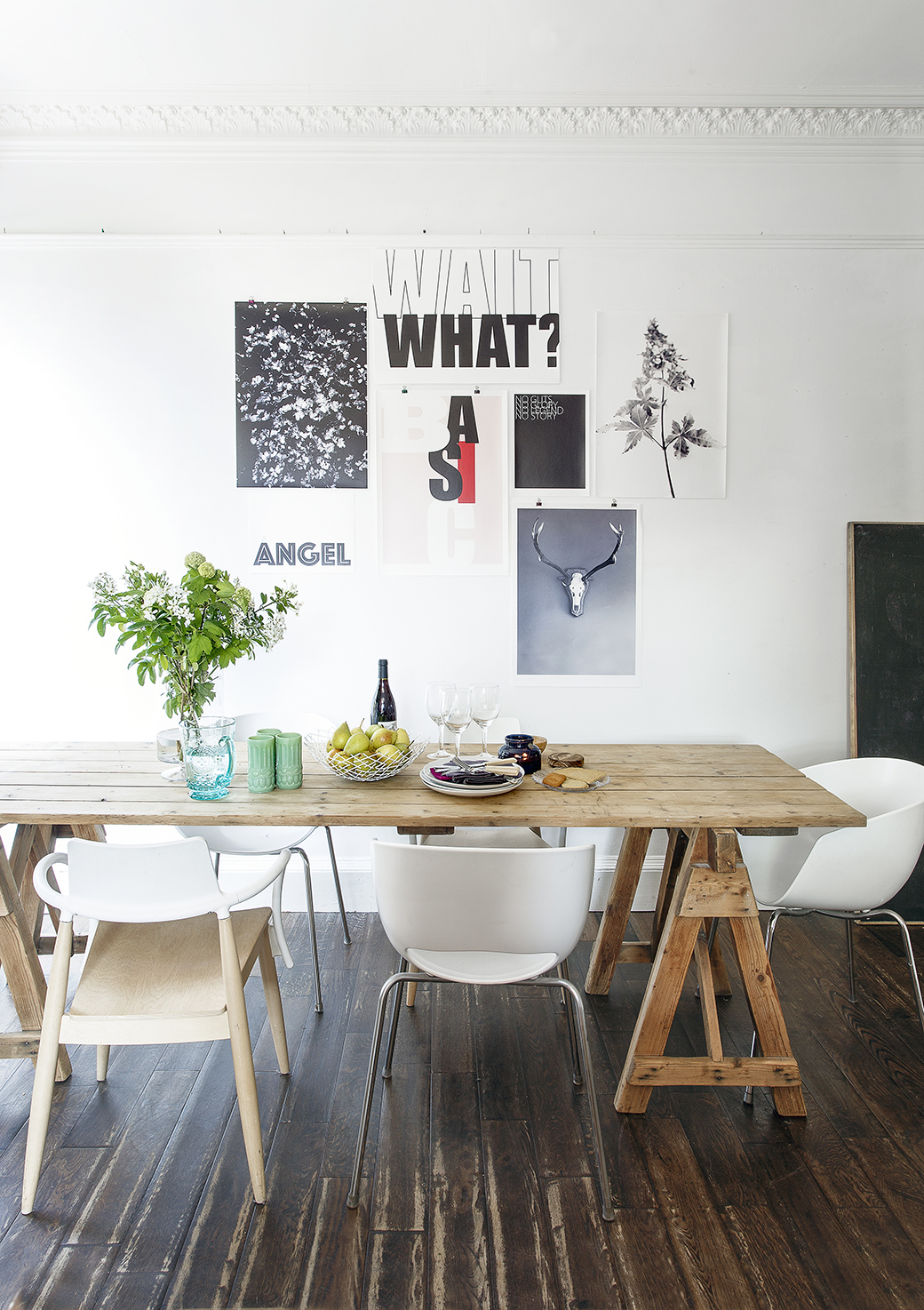 A selection of prints from We Are Amused are artfully arranged, unframed, held up by white tack, bulldog clips add a functional, decorative note.