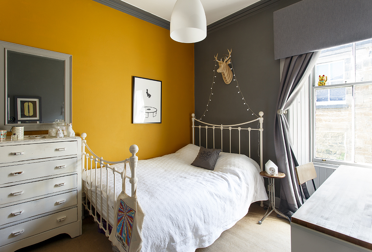 The orange wall is painted in Mustard by Dulux.