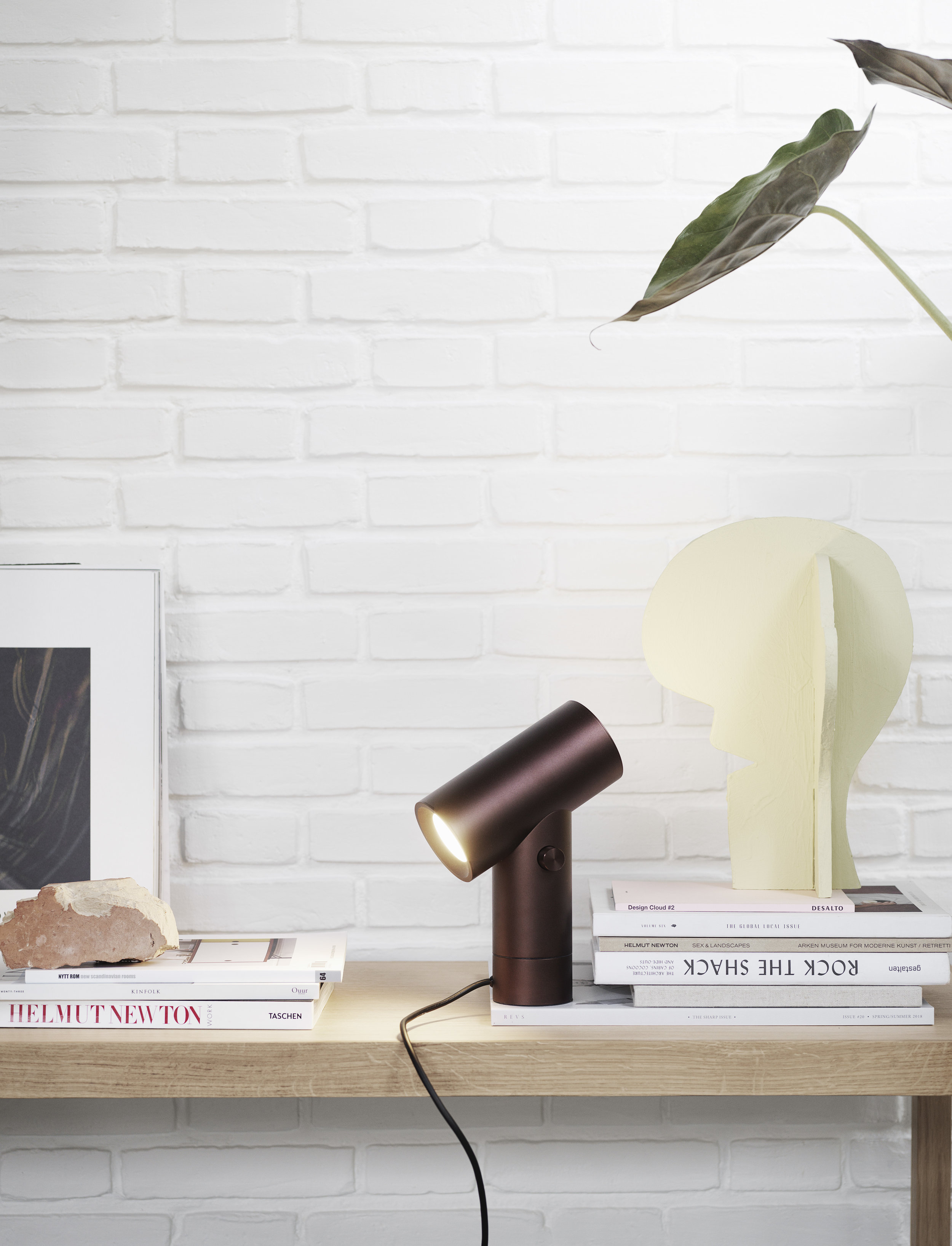 New lamp from Muuto which can shine up, down, or both simaltaneously - and it can swivel, too!