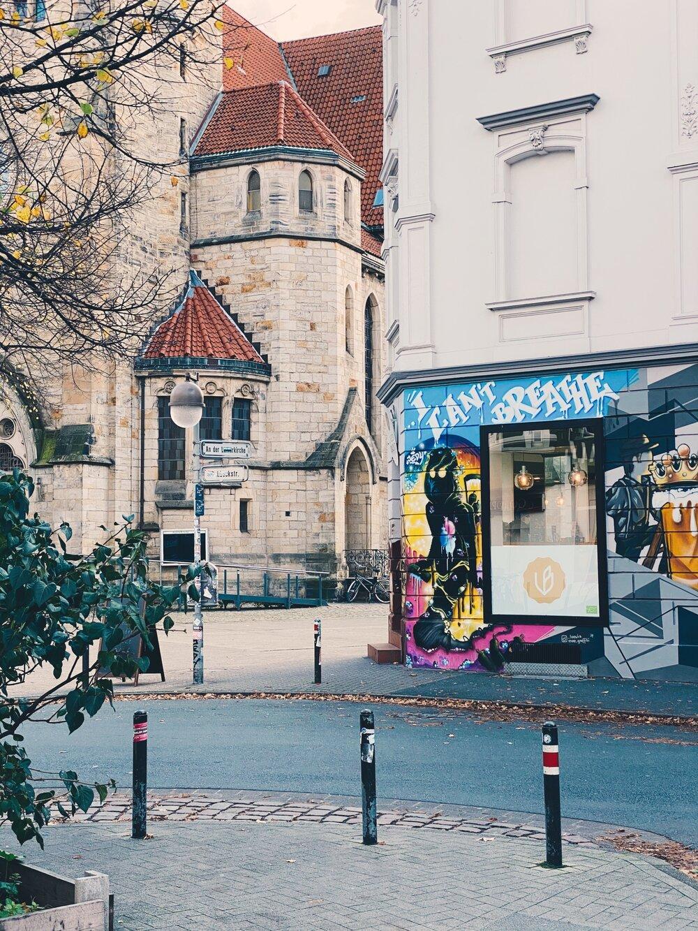 "Contrast - proper church and ""I can't breathe"" graffiti"