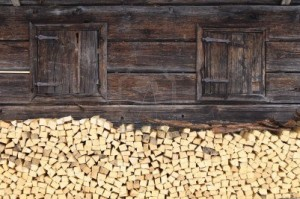 wood pile against wood cabin