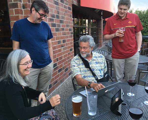 GWG members at the The Commons pub  after the 2017 meeting. On the left are Dr. Maura McGrail and Dr. Jeff Essner from Iowa State University. Dr. Perry Hackett, University of Minnesota, is seated at the computer. Jeff Haltom, a graduate student in Dr. McGrail's' group is on the right.