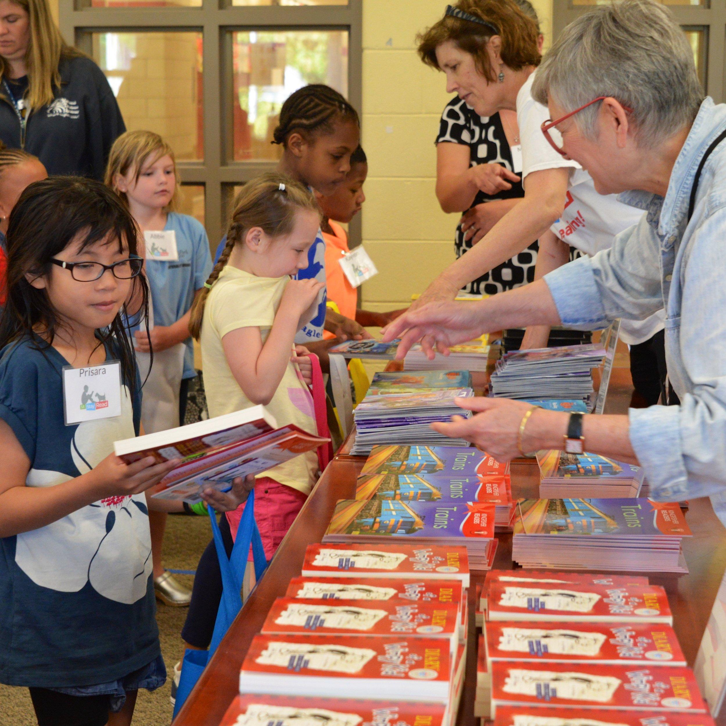 Volunteers at National Teacher's Academy - Keep Reading Celebration