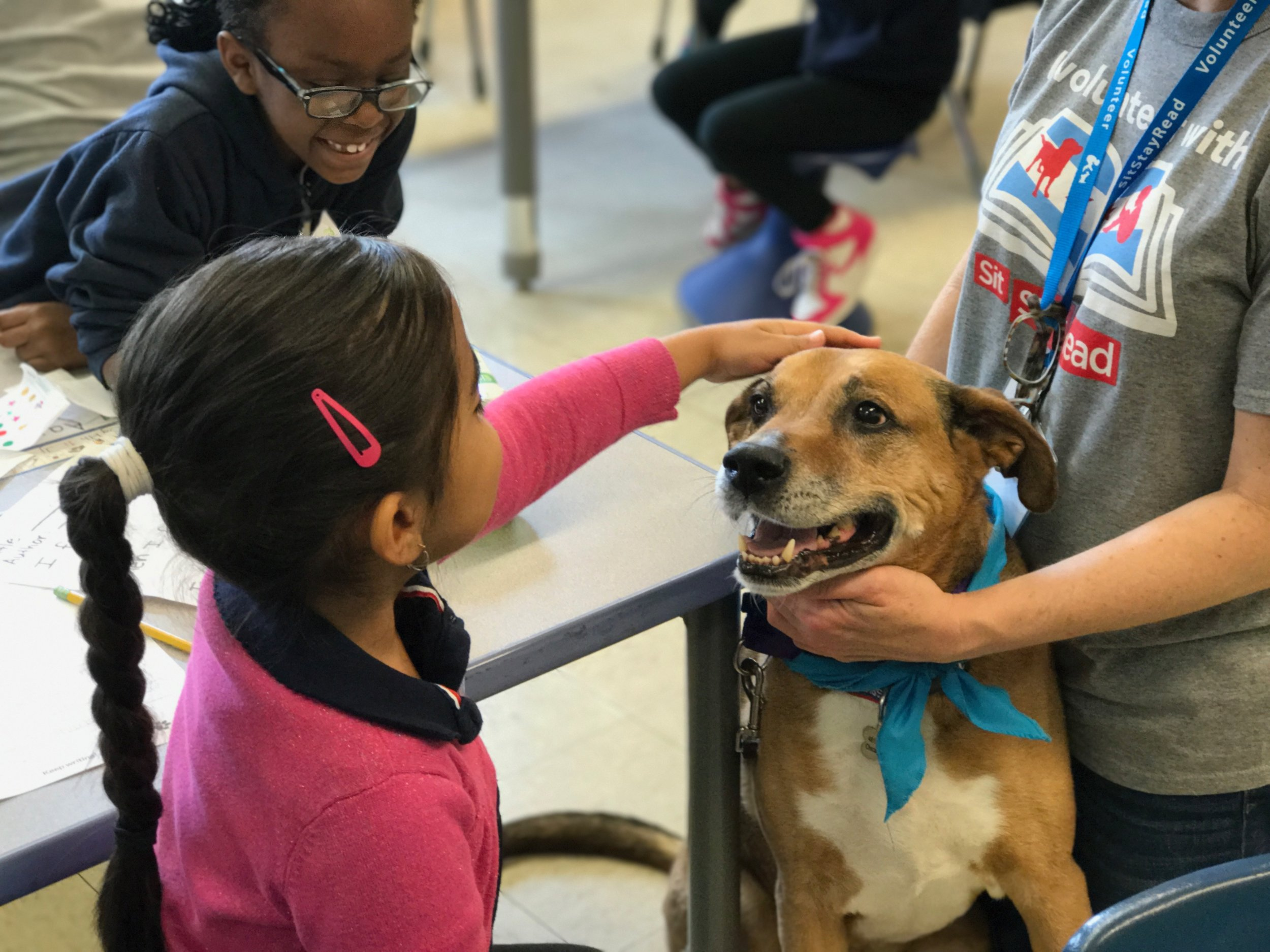 Ms. Lori has Certified Reading Assistance Dog, Buster, meet students in the Little Buddies program at Cameron Elementary.
