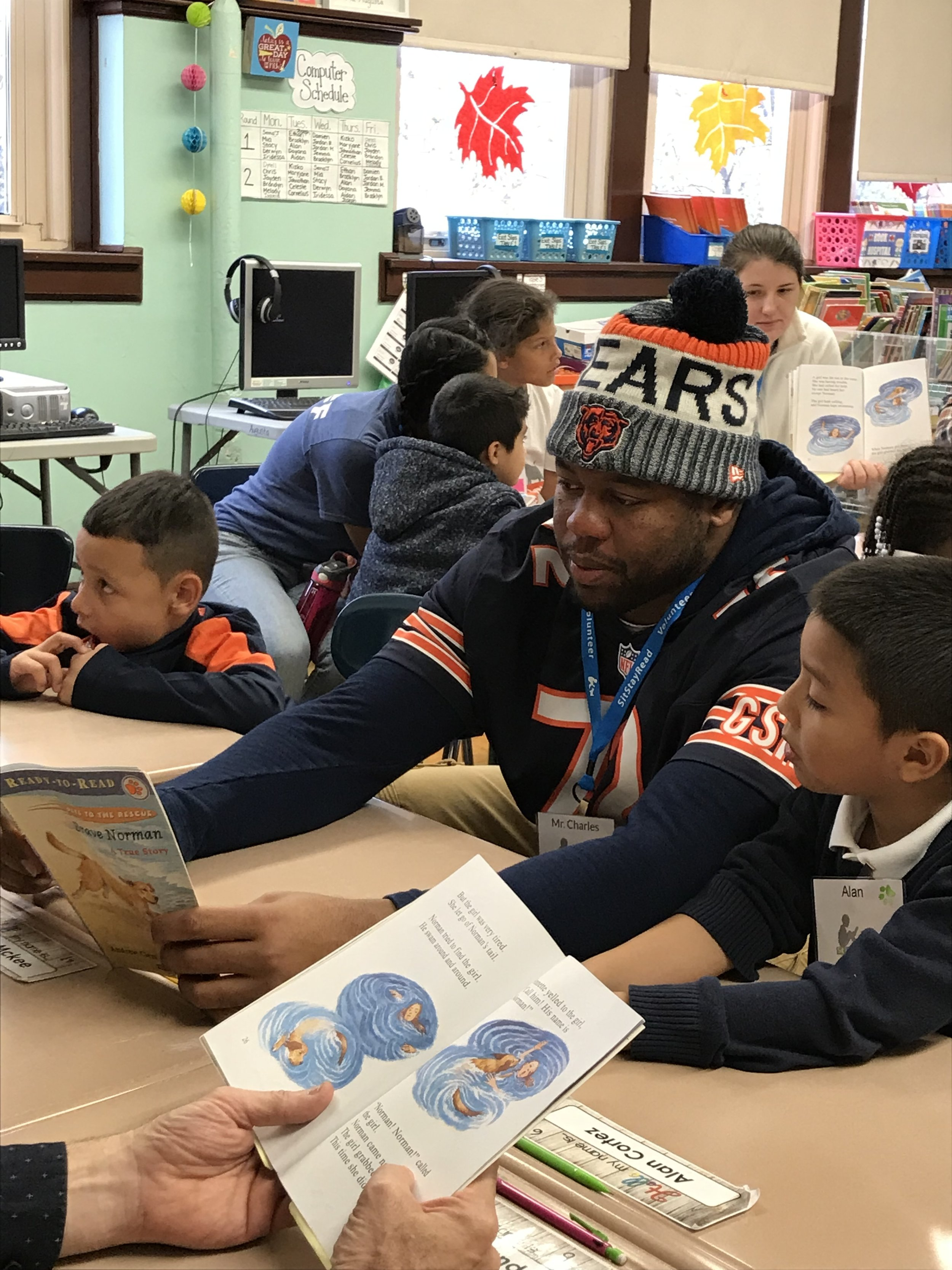 Charles Leno Jr. reads  Brave Norman  with second-grader Alan at Lowell Elementary.