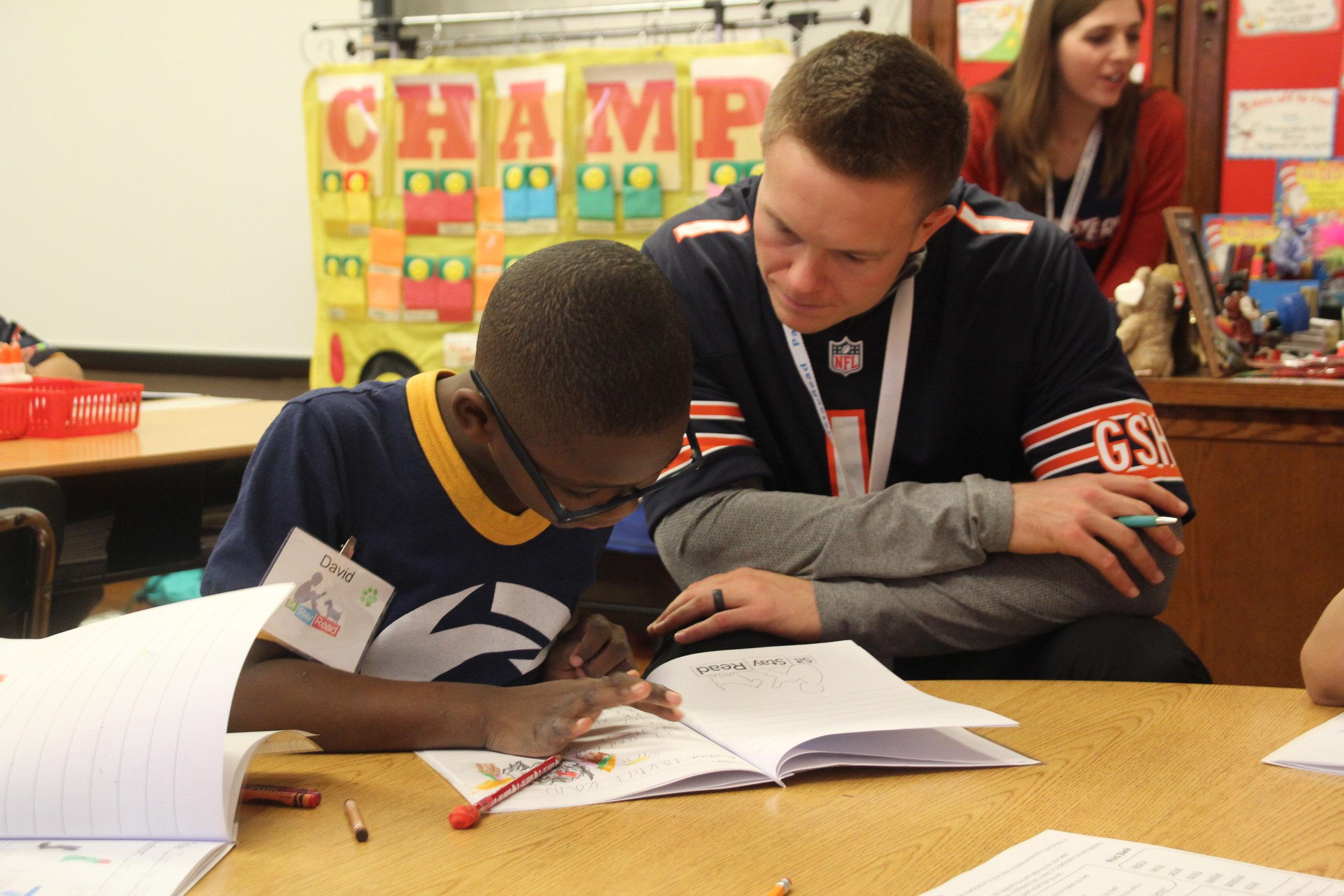 Student David reads to Cody