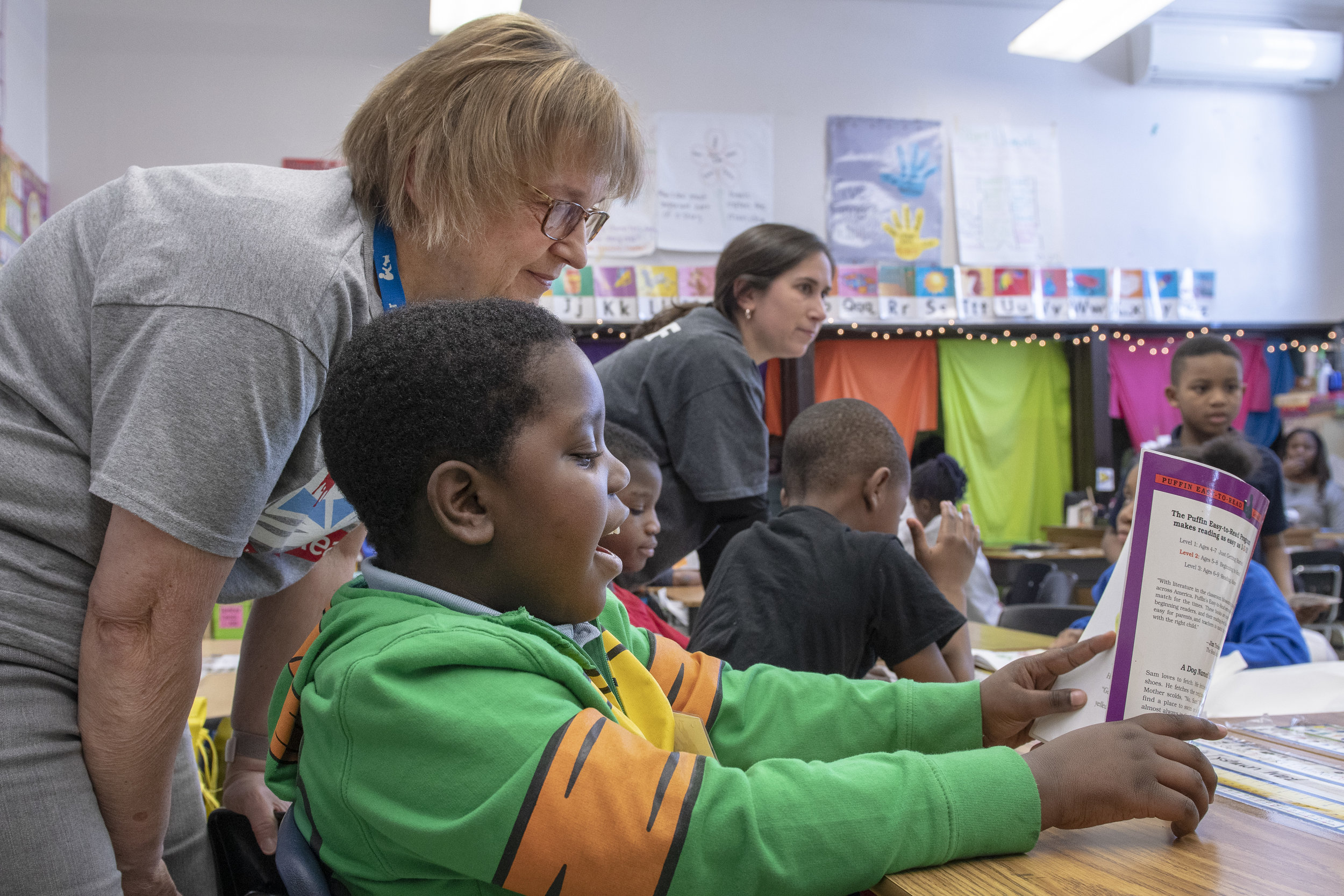 Book Buddy volunteer Rhonda reads with second-grader TyShawn in Ms. Alexander's Tail Blazers program at Melody Elementary. (J. Sall)