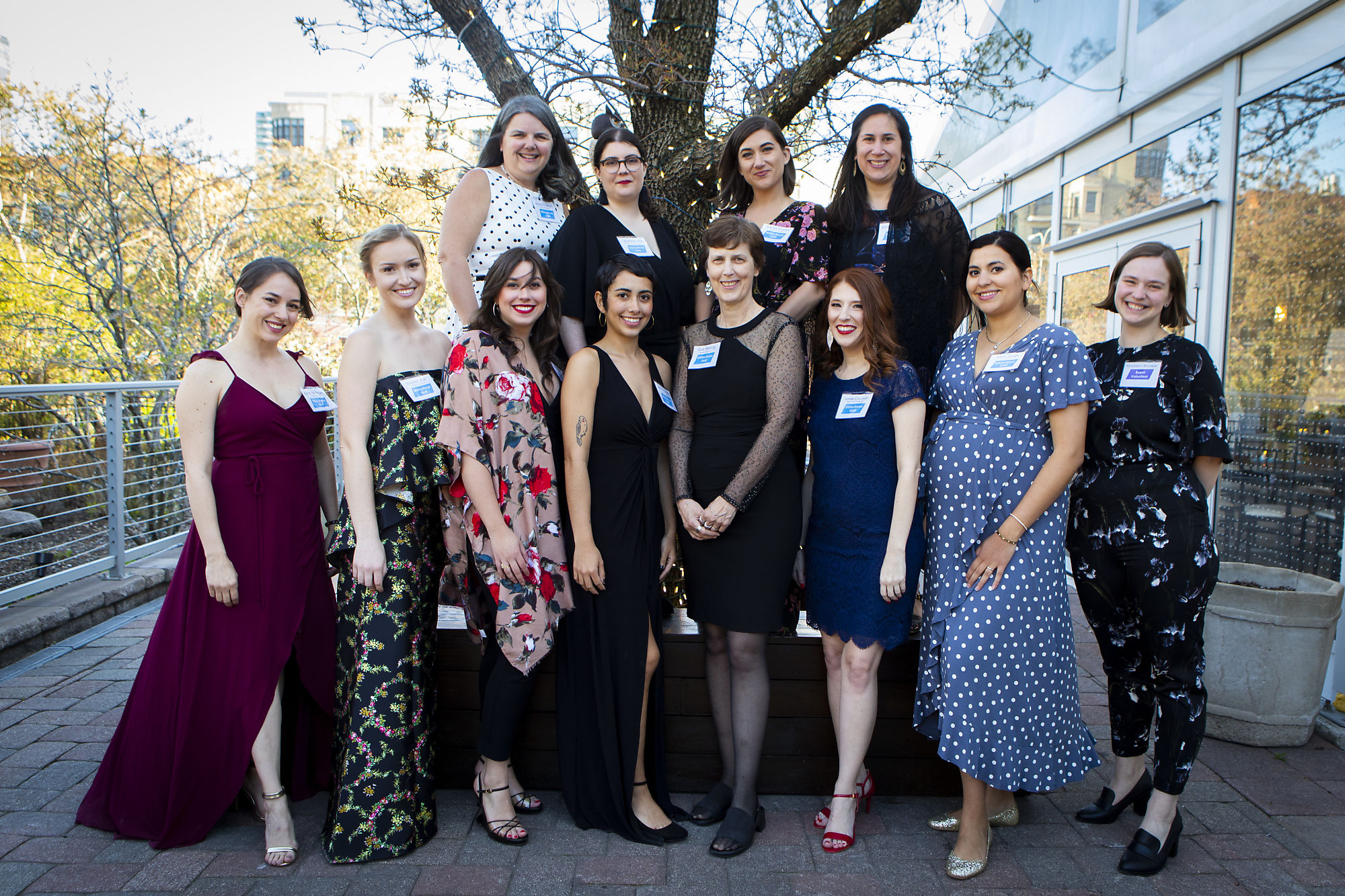 The SitStayRead Staff at Bark 'n Ball 2019. From left to right: (Top) Mara O'Brien, Victoria Luisi, Sarah Mylan, Emily Shayman. (Bottom) Kate McIlvain, Lauren Ash, Joan Figarella, Mimi Rosales, Sue Hiering, Jamie Crockett, Mimi Singh, and Madalyn Brooker   (   Crimson Cat Studios   )