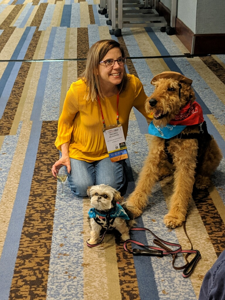 Medical Library Association (MLA) Member Melissa meeting Certified Reading Assistance Dogs Buddy and Bambi at the MLA's annual conference.