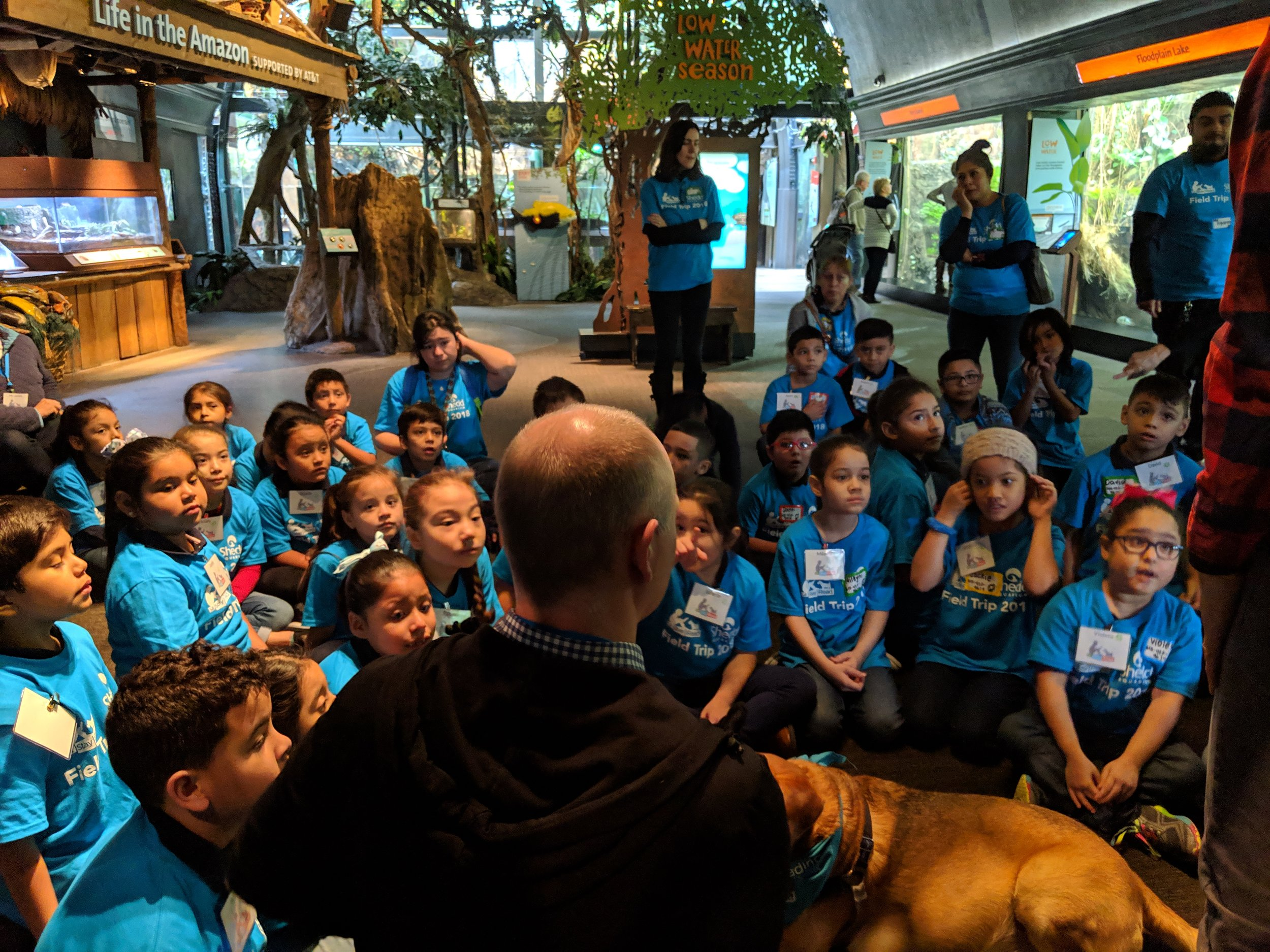 Students listen to Mr. Max, the Shedd Aquarium's Program Leader, for instructions about their activity.