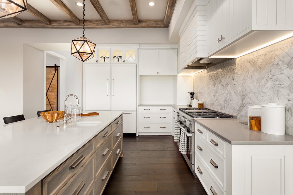 Wide Engineered Hardwood Floors and Marble Tile Herringbone Backsplash Installed in a Kitchen (Medium Size).jpg