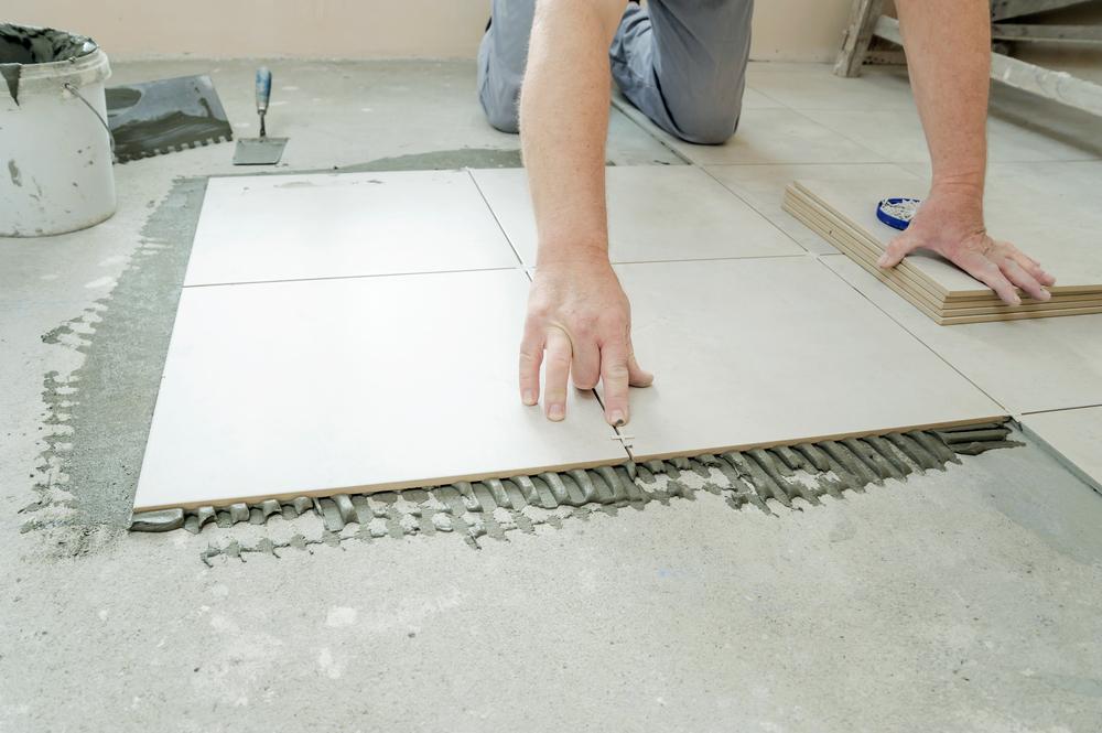 Installer Putting Spacers In Between Porcelain Tile Floors (Medium Size).jpg