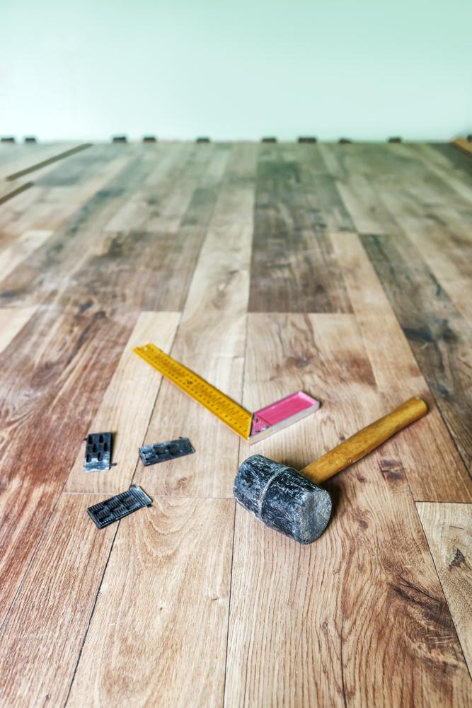Laminate Floor Installation with Spacers (Medium Size).jpg