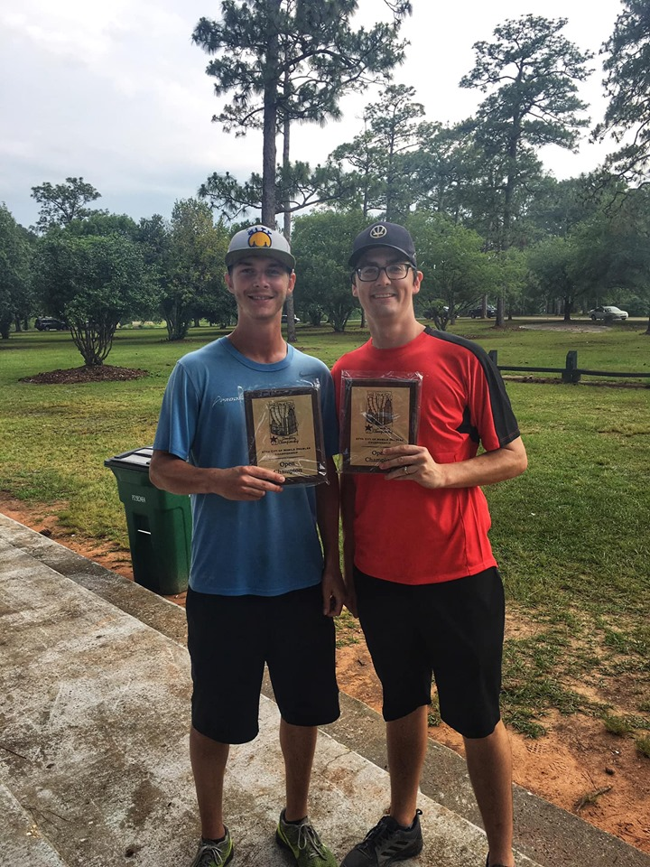 Cameron Colglazier and Michael Gibney pose with their City of Mobile Doubles Championship plaques.