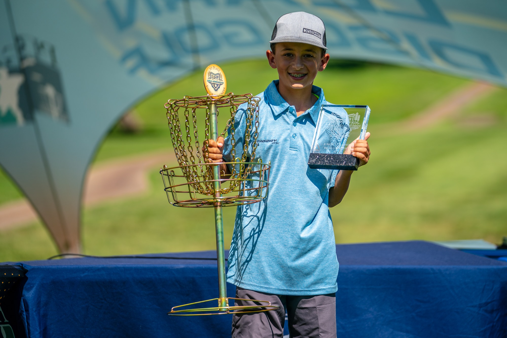 Kolby Sanchez accepting his trophies at the 2019 PDGA Junior World Championships.