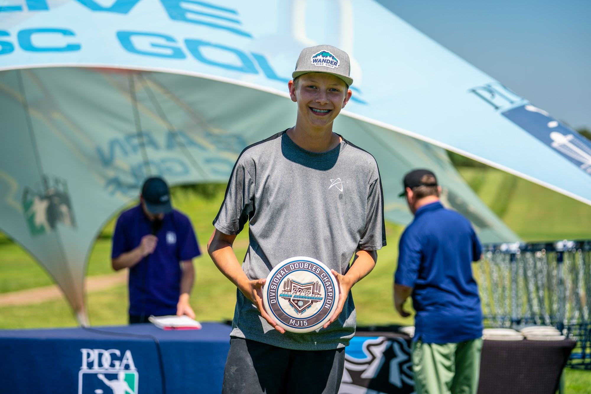 Gannon Buhr accepting one of his trophies at the 2019 PDGA Junior World Championships.