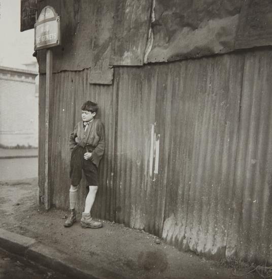 Dora Maar,Gamin aux Chaussures Dépareillés, 1933, vintage gelatin silver print, 11 x 11 inches