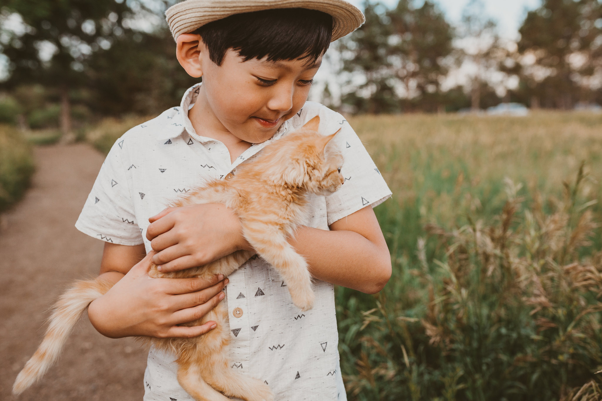 nizhoni photography little boy with fedora and orange kitten