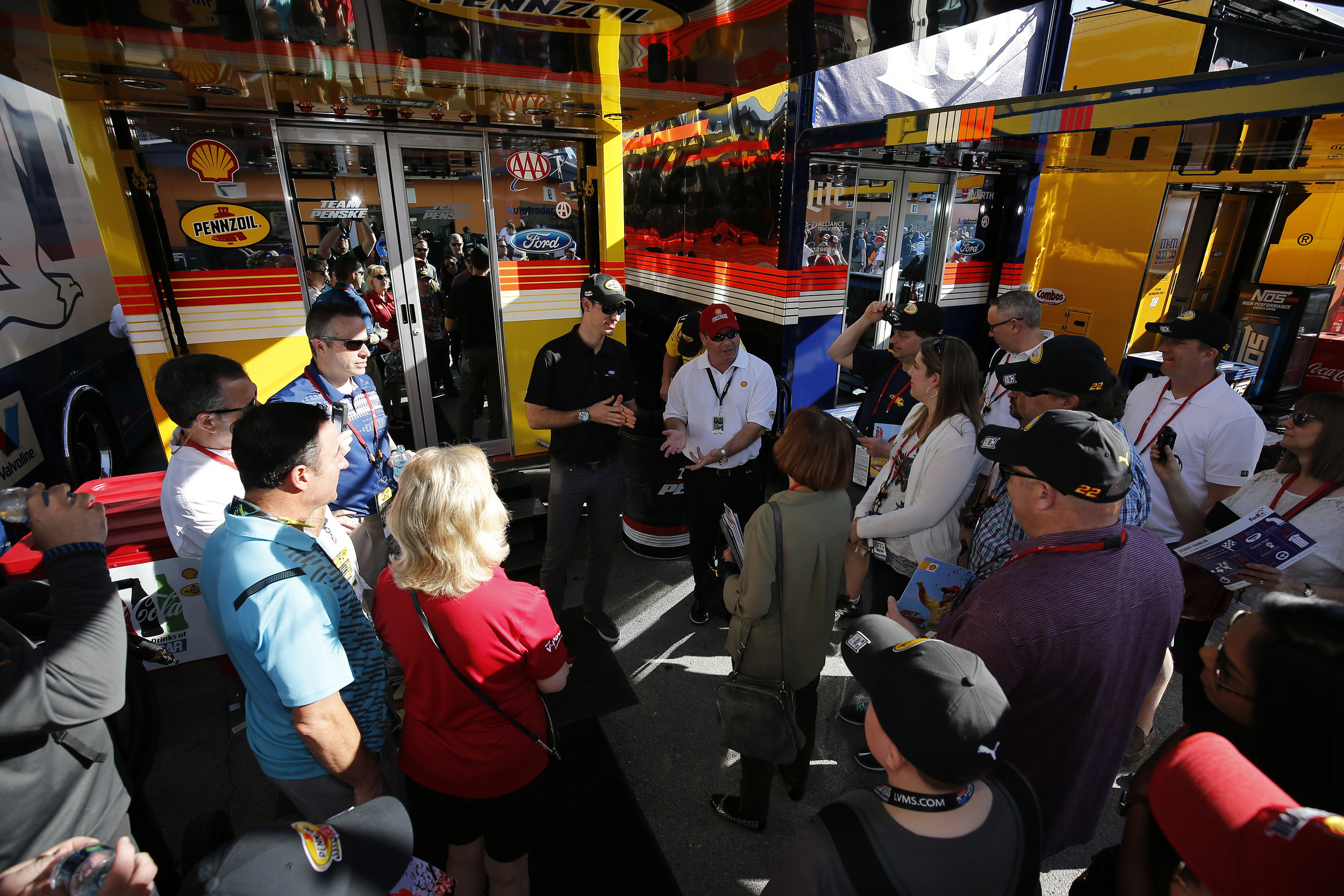 Guests from the UFA meet with Joey inside the garage.