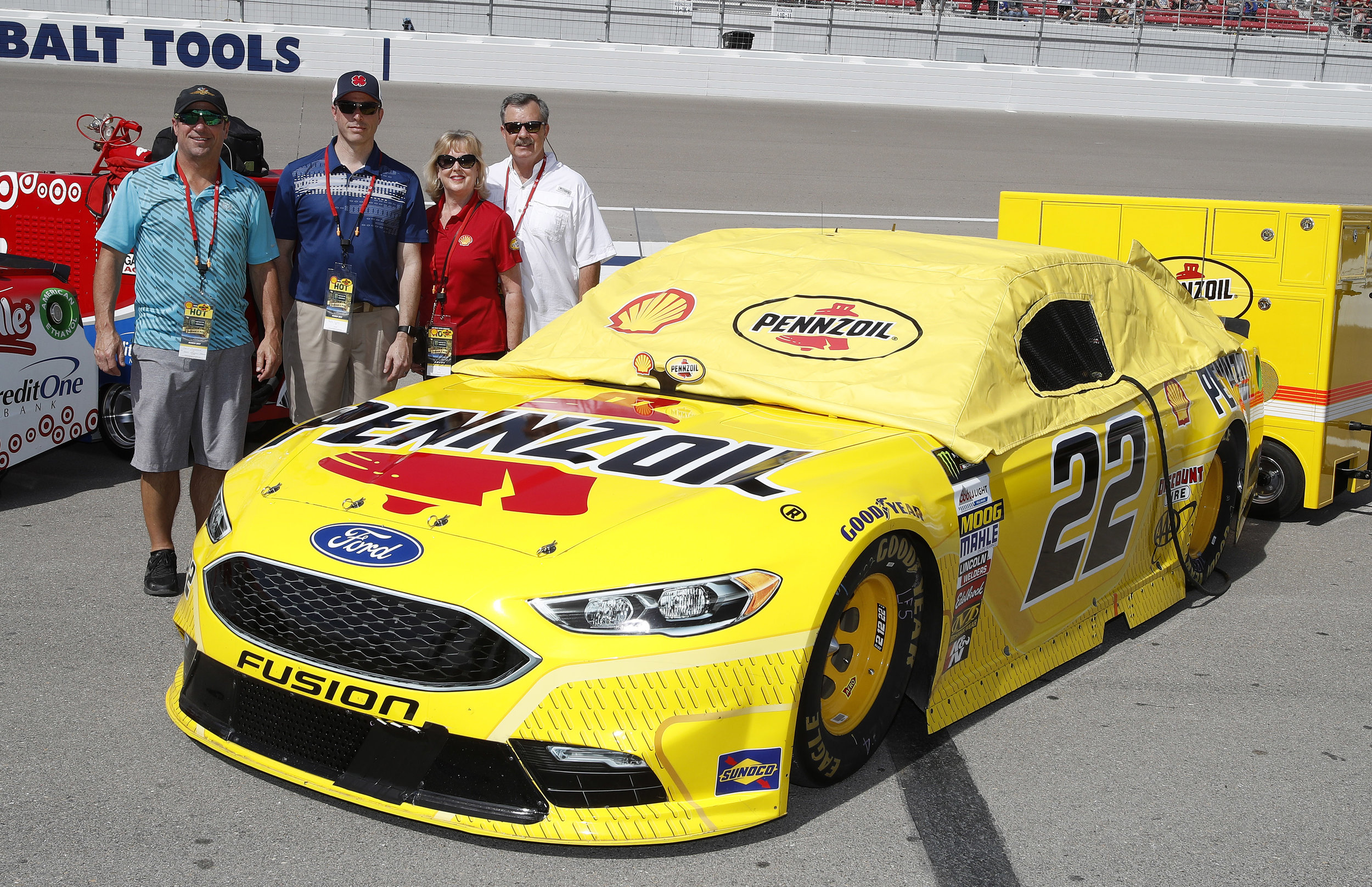 Contest winners from Core-Mark and RacePro enjoy pit road before the race.