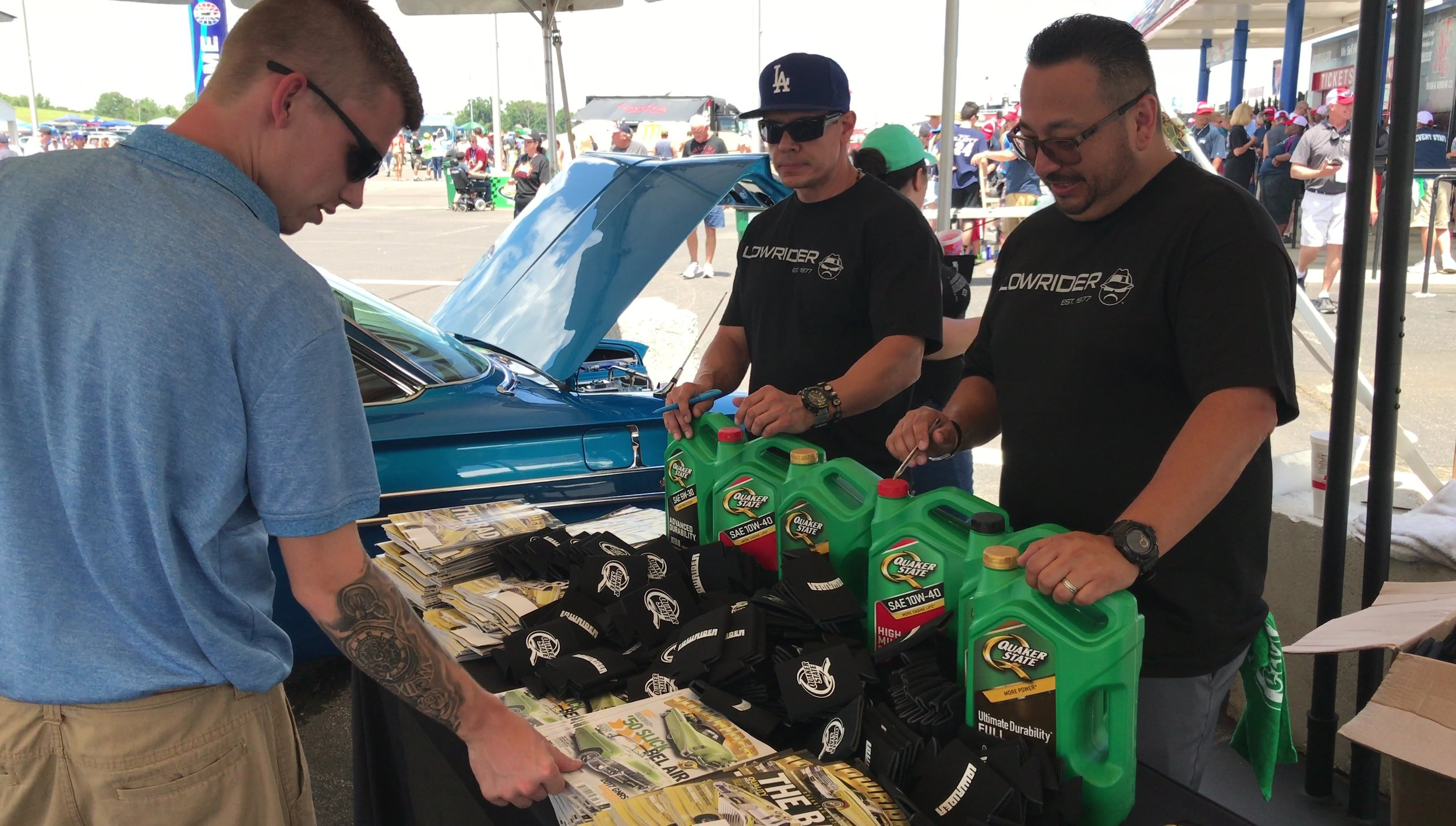 The Lowriders engage fans and customers ahead of the Quaker State 400.