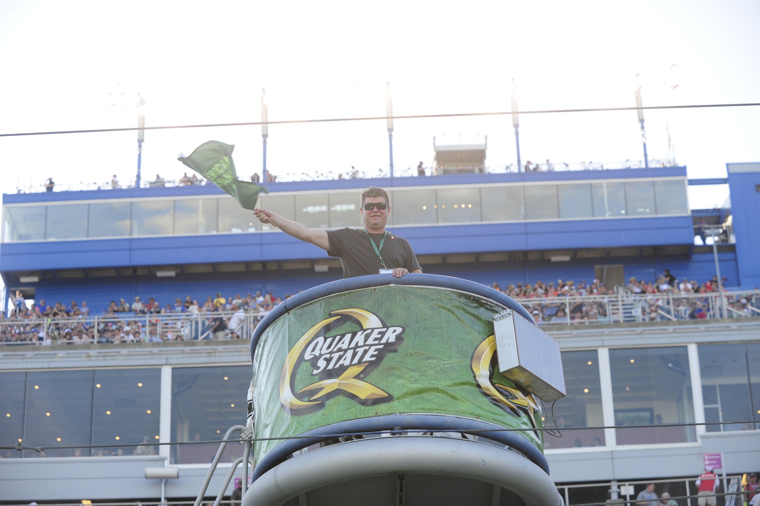 Jeff Couturier starting the Quaker State 400 in style by waving the green flag.