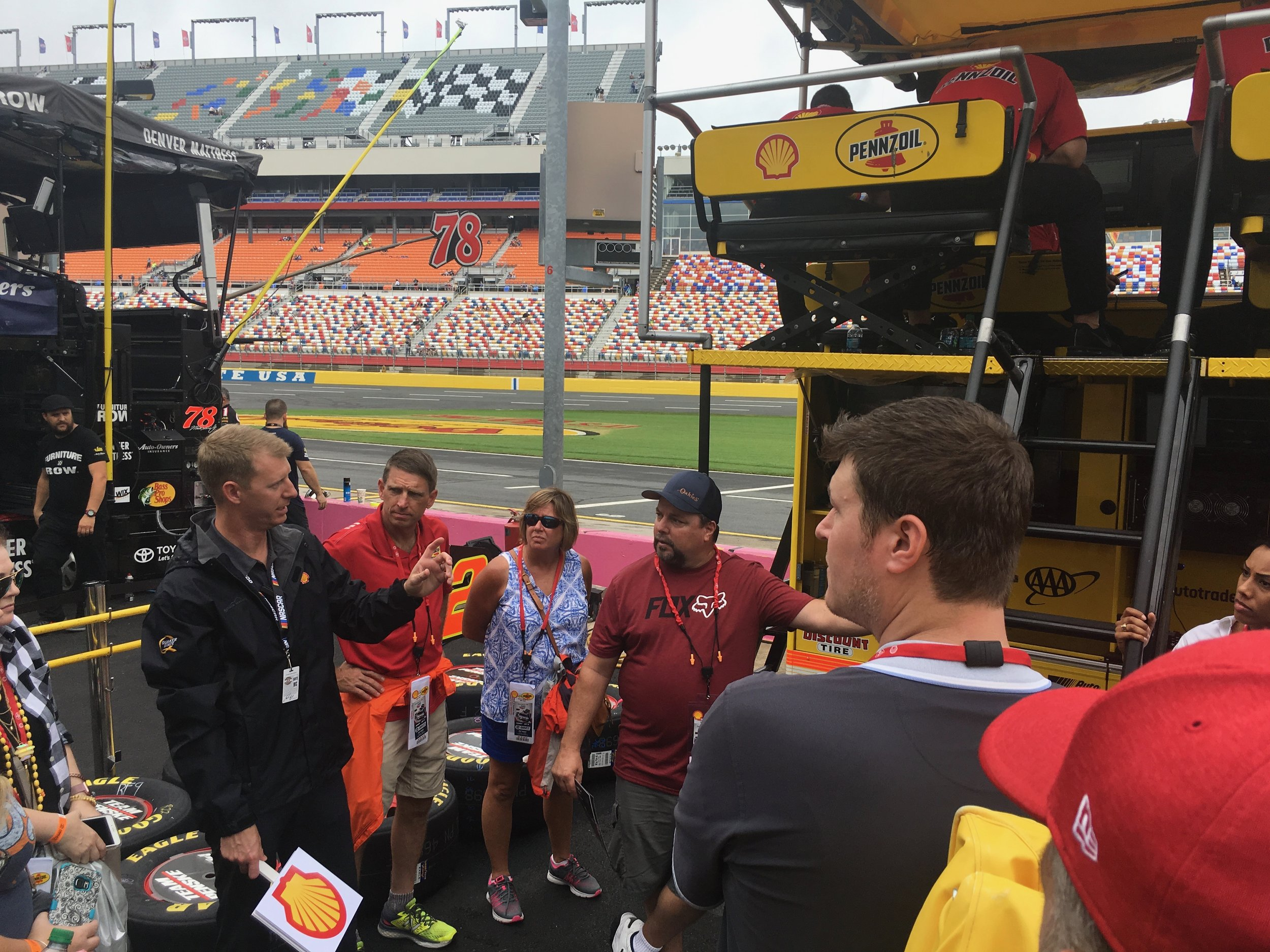 Guests go behind the scenes with an exclusive tour of the NASCAR pits.