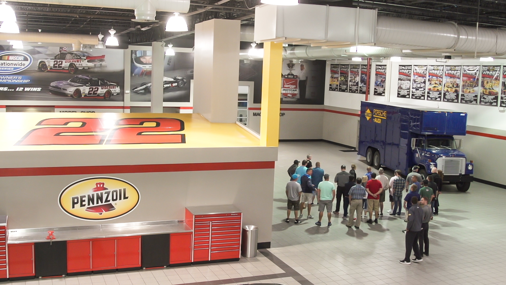 Guests get a behind the scenes tour at Team Penske.