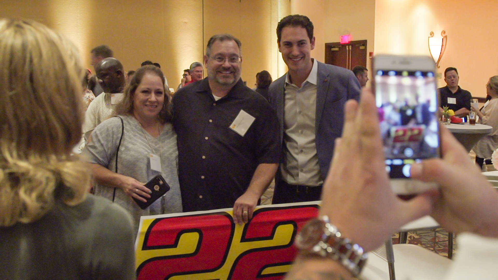 Joey Logano meets with customers at dinner Saturday night.
